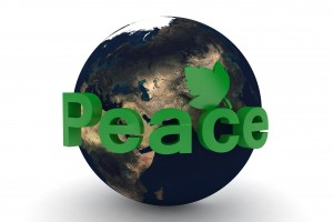 green planet with the word peace